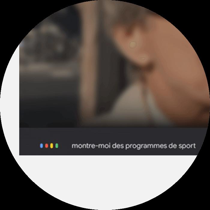 Image de la deuxième étape, la requête «montre-moi des programmes de sports'affiche en bas de l'écran de la télévision connectée - Bouygues Telecom