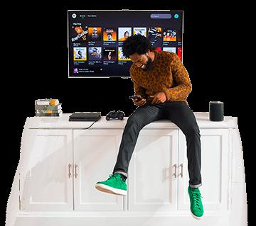 Image d'un homme écoutant la musique grâce à Spotify Premium